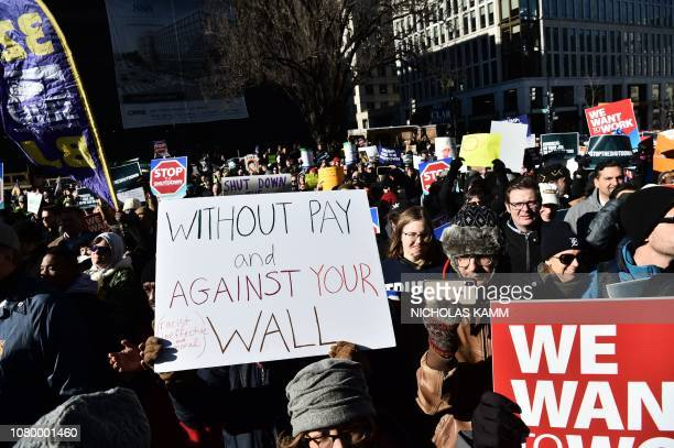 Union workers demonstrate against the government shutdown on January 10 in Washington DC US President Donald Trump headed Thursday to the USMexico...