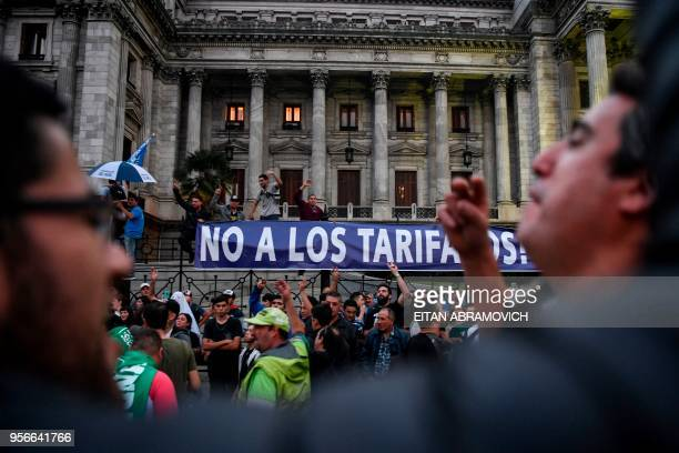 Union workers demonstrate while legislators debate a bill to put a stop on public services taxes raising in Buenos Aires on May 09 2018 Argentina...
