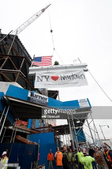 Union workers from New York City Iron Workers Local 40 raise