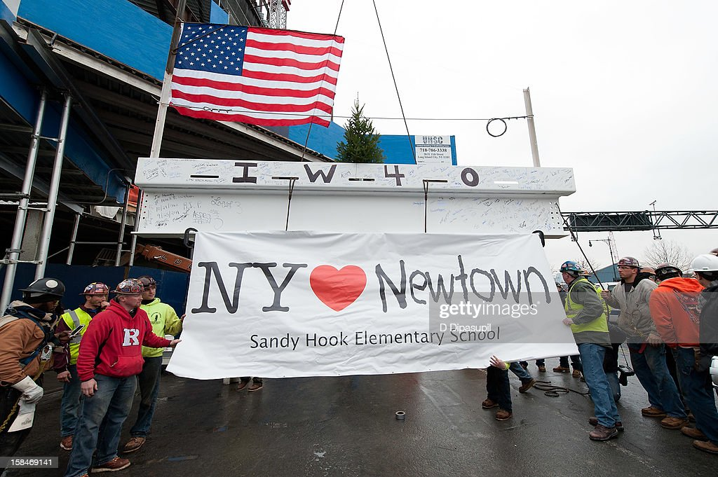 Union workers from New York City Iron Workers Local 40 raise a beam