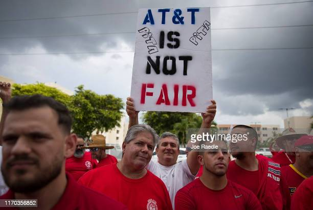 Union workers picket near the entrance to an AT&T facility as the Communications Workers of America strike against the company alleging AT&T...