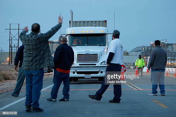 Union workers slow a truck with a load of borax leaving the front gate of the Rio Tinto Borax mine on the day after mine owners locked out about 540...