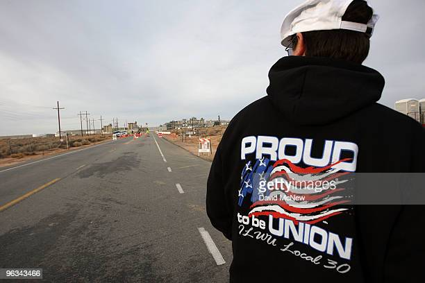 Union workers stand in the road at the front gate of the Rio Tinto Borax mine on the day after mine owners locked out about 540 employees and called...