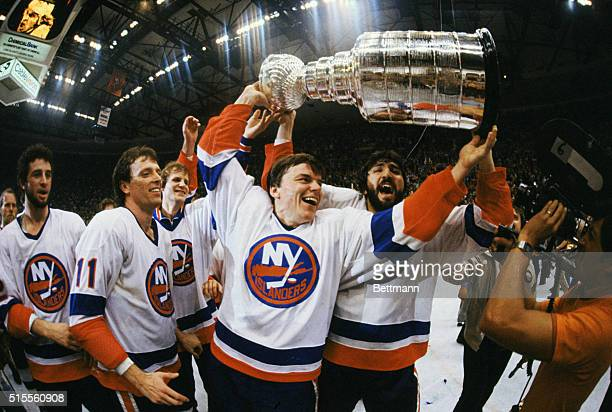 Islands raise Stanley Cup May 21 after defeating North Stars 51 in fifth game Anders Kallur and John Tonelli of Islanders raise Stanley Cup May 21