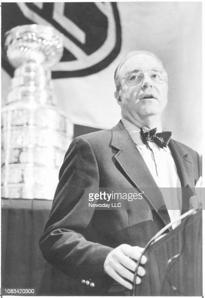 Bill Torrey President and General Manager of the New York Islanders introduces the coaches to the media at a press conference before the NHL AllStar...