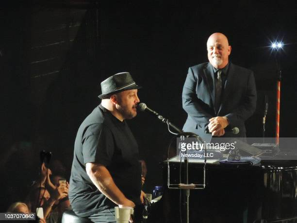 Kevin James joins Billy Joel during the final concert at the Nassau Coliseum on August 4, 2015 in Uniondale, New York.