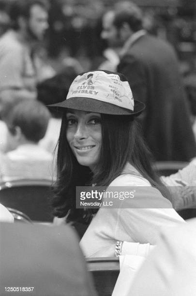 On June 22 a woman in the audience at the Elvis Presley Show at the Nassau Coliseum in Uniondale, New York, wears Elvis hat.