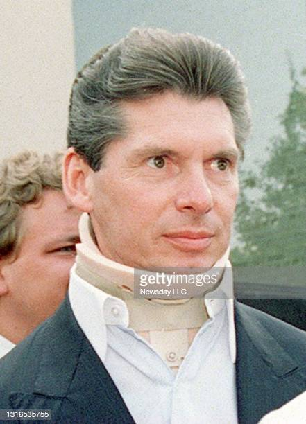 Wrestling promoter Vince McMahon wears a neck brace as he leaves United States federal court in Uniondale, New York on November 10, 1995. McMahon is...