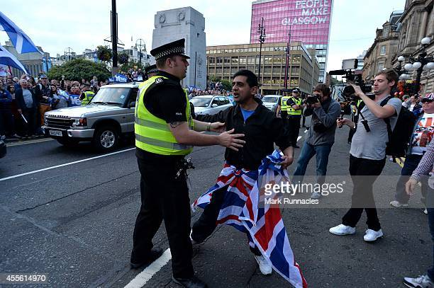 Unionist protesters arrive in George Square at a ''Yes'' rally during the final day of campaigning for the Scottish referendum ahead of tomorrows...
