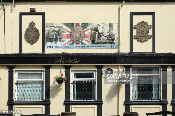 unionist pub with a picture reminding the formation of the ulster volunteer force in 1913 - rainer grosskopf stock pictures, royalty-free photos & images