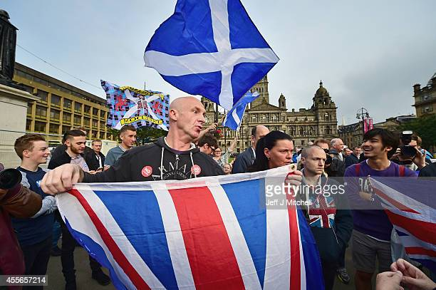 Unionist supporter talks with a yes supporter in George Squarejust a few hours befor polling station will close in the Scottish independence...