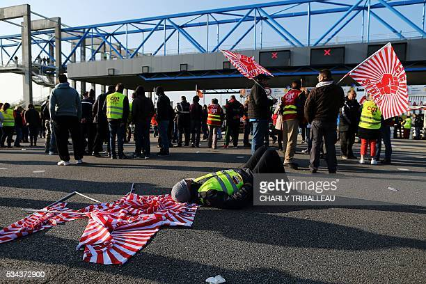 Unionists block the tollgate of the 'Pont de Normandie' in Le Havre northwestern France on May 26 to protest against the government's proposed labour...