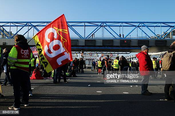 Unionists block the tollgate of the 'Pont de Normandie' in Le Havre northwestern France on May 26 to protest against the government's proposed lab...