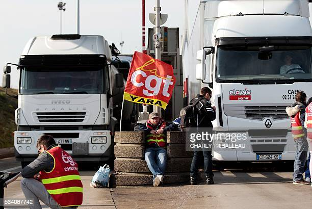 Unionists block the trucks' tollgate of the 'Pont de Normandie' in Le Havre northwestern France on May 25 to protest against the government's...