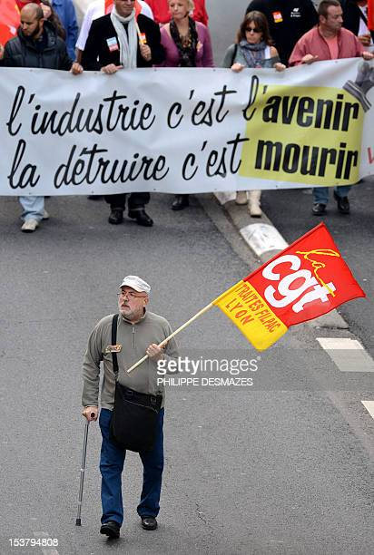 CGT unionists hold a banner as they demonstrate on October 9 2012 in Lyon against unemployment in the French industry AFP PHOTO/PHILIPPE DESMAZES