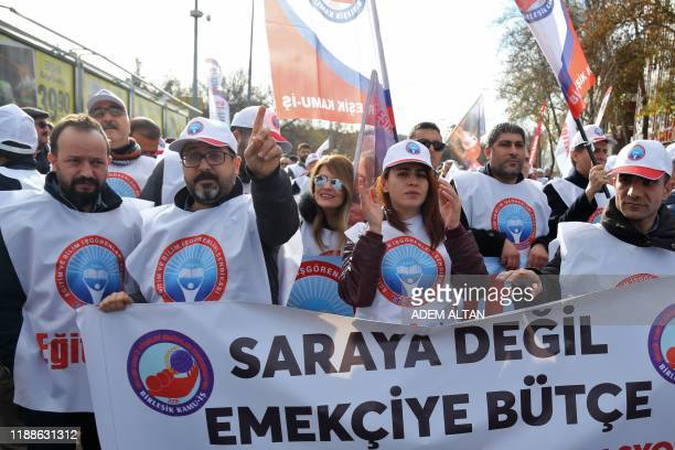 """Unionists hold a banner reading """"Budget to workers, not to palaces"""" as they protest against the government's economic policies in Ankara on December..."""
