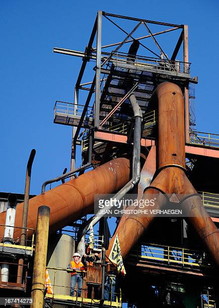 CFDT unionists of steel giant ArcelorMittal's blast furnaces of Florange eastern France install a black flag on the blast furnace on April 25 2013 in...