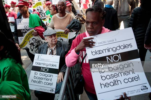 Unionized Bloomingdale's employees and their supporters rally for fair wage increases and improved health care benefits outside of Bloomingdale's...
