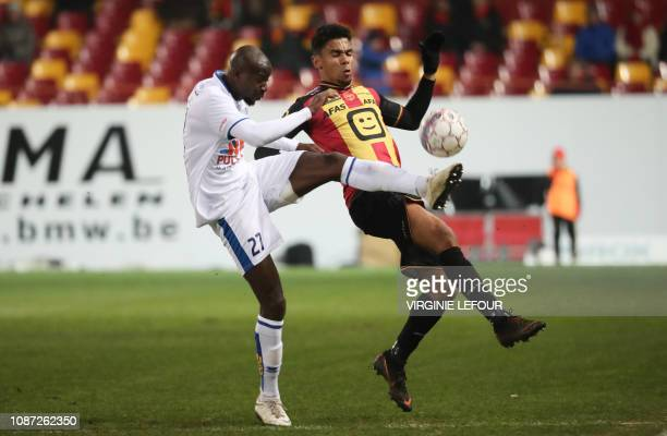 Union's Hadamou Traore and Mechelen's Igor de Camargo fight for the ball during a soccer game between KV Mechelen and Royale Union Saint Gilloise...