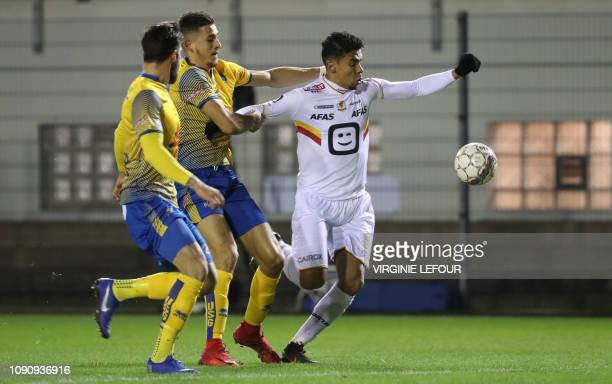 Union's Ismael Kandouss and Mechelen's Igor de Camargo fight for the ball during a soccer game between Royale Union Saint Gilloise and KV Mechelen...