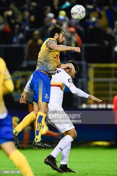Union's Pietro Perdichizzi and Mechelen's Igor de Camargo fight for the ball during a soccer game between Royale Union SaintGilloise and KV Mechelen...