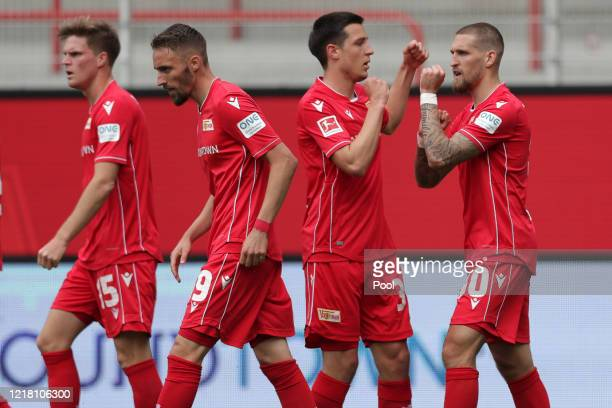 Union's Robert Andrich celebrates with his team after scoring his side's first goal during the Bundesliga match between 1. FC Union Berlin and FC...