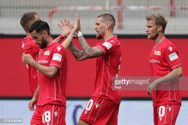 Union's Robert Andrich second right celebrates after scoring his side's first goal during the Bundesliga match between 1 FC Union Berlin and FC...