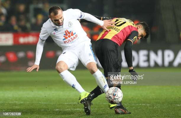 Union's Teddy Teuma and Mechelen's Igor de Camargo fight for the ball during a soccer game between KV Mechelen and Royale Union Saint Gilloise...