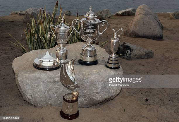 Unique collection of trophies The Abu Dhabi HSBC Championship Trophy sits at the front of the golfing world's four Major trophies left to right - The...