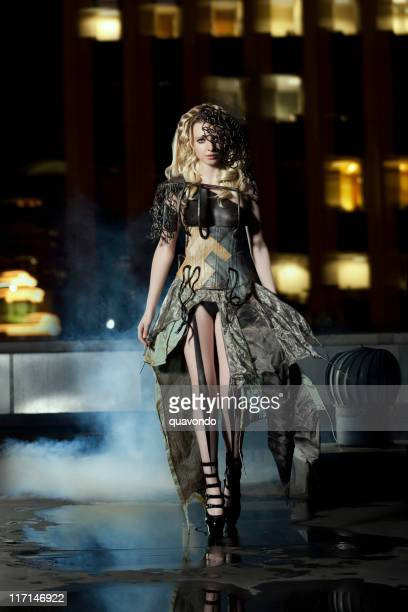 Beautiful Young Female Fashion Model in Couture Gown on Rooftop