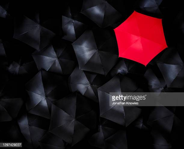 unique red umbrella - elevated view stock pictures, royalty-free photos & images