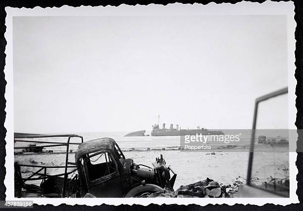 A unique snapshot taken by a German soldier after the British withdrawal from Dunkirk showing a scuttled battleship and ruined transport during World...