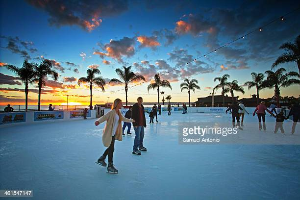 CONTENT] A unique Southern California Christmas experience outdoor ice skating while overlooking the Pacific Ocean with the sun setting Hotel Del...
