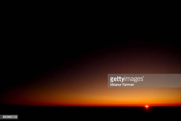 unique sunset - mizanur rahman stock pictures, royalty-free photos & images