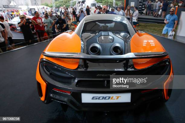A unique topexit exhaust system featuring twin pipes sits on the McLaren 600LT supercar manufactured by McLaren Automotive Ltd during its launch at...