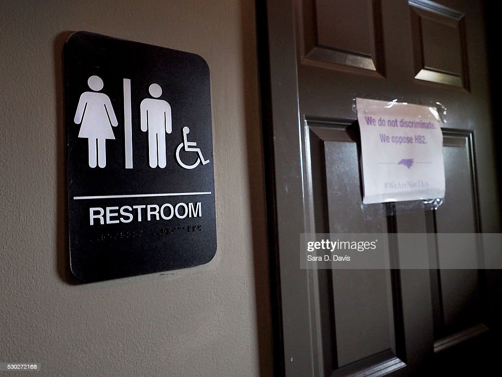 A unisex sign and the 'We Are Not This' slogan are outside a bathroom at Bull McCabes Irish Pub on May 10, 2016 in Durham, North Carolina. Debate over transgender bathroom access spreads nationwide as the U.S. Department of Justice countersues North Carolina Governor Pat McCrory from enforcing the provisions of House Bill 2 that dictate what bathrooms transgender individuals can use.