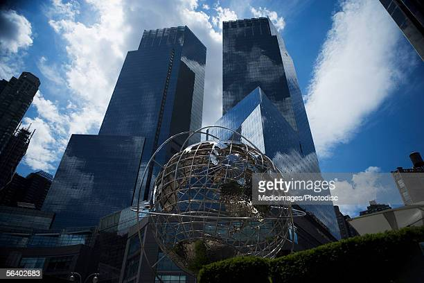unisphere in front of trump international hotel and tower, new york city, ny, usa - ユニスフェア ストックフォトと画像