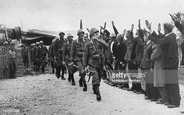 A unit of Italian grenadiers just off the plane at the airport of the Albanian capital Tirana heading towards the city receiving greetings from...