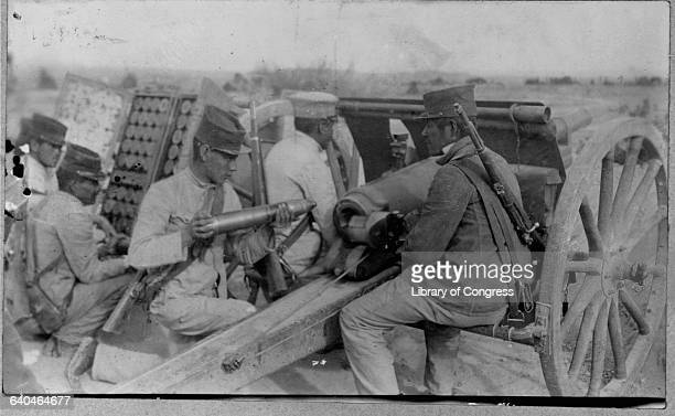 A unit of Mexican soldiers fires their cannon during the siege of Ojinaga in 1914 during the Mexican Revolution Chihuahua Mexico | Location Ojinaga...