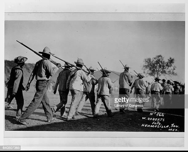A unit of Mexican soldiers march in the desert near Hermosillo during the Mexican Revolution Sonora Mexico | Location near Hermosillo Sonora Mexico