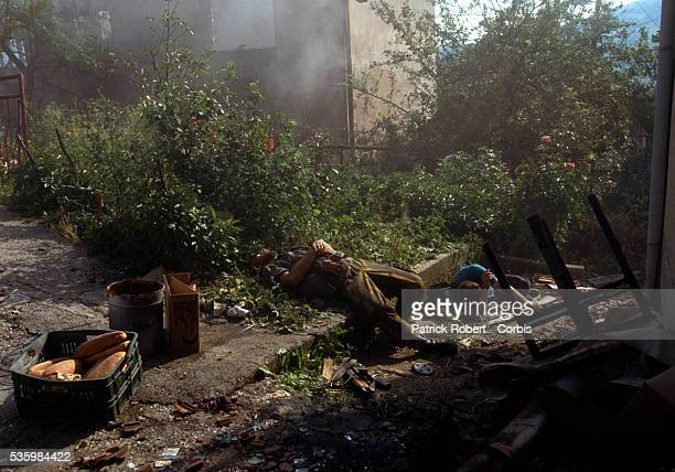 A unit of Muslim soldiers tries to attack Serb defenses surrounding the city A mortar rocket falls in front of the Bosnian soldiers' shelter during...