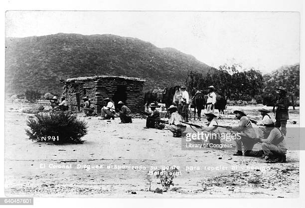 A unit of rebels led by El Coronal Dieguez shoots in the desert during the Mexican Revolution Hermosillo Sonora Mexico