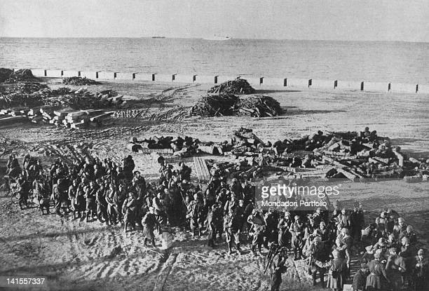 A unit of riflemen just landed on the beach of the Albanian town of Durres expecting to move inlandáDurres 7th April 1939