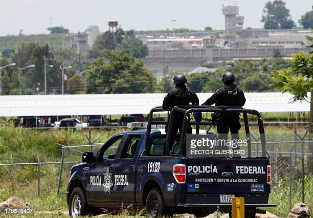 A unit of the Mexican Federal Police patrols the surroundings of the Puente Grande State prison in Zapotlanejo Jalisco State Mexico on 9 August 2013...