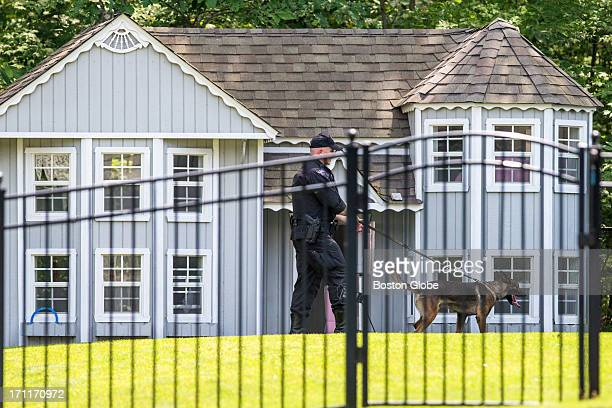 K9 unit of the State Police searched the backyard and play house at the home of New England Patriots player Aaron Hernandez in North Attleborough...