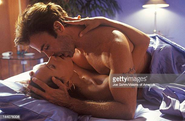 Unit photography of love scene between Jeff Fahey and Patricia Durham of 'Temptation' Miami FL