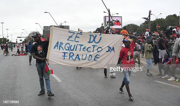 Unita activists hold a banner during a protest in the center of Luanda on August 25 2012 to ask for free and fair elections Angola's main opposition...