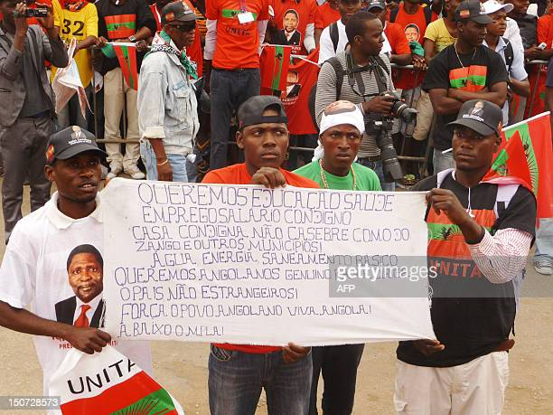 Unita activists hold up a banner during a protest in the center of Luanda on August 25 2012 to ask for free and fair elections Angola's main...
