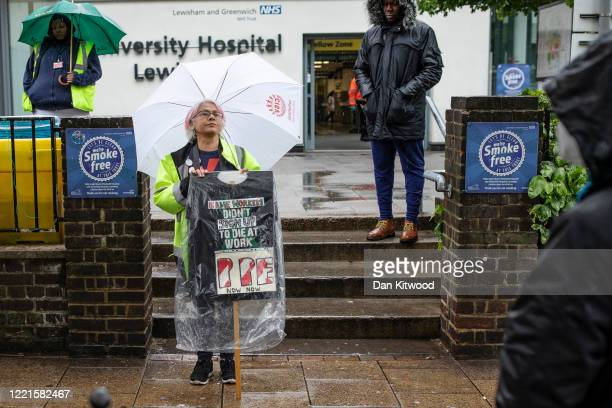 Unite members hold a minute's silence outside Lewisham Hospital on April 28, 2020 in London, United Kingdom. The moment of silence, commemorating the...
