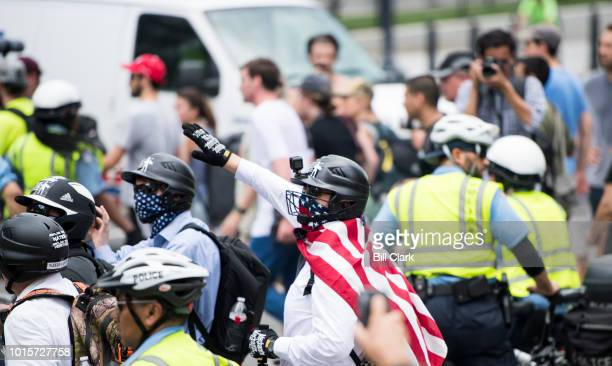 Unite the Right protesters march with a police escort to their rally in Lafayette Square across from the White House on the anniversary of the...